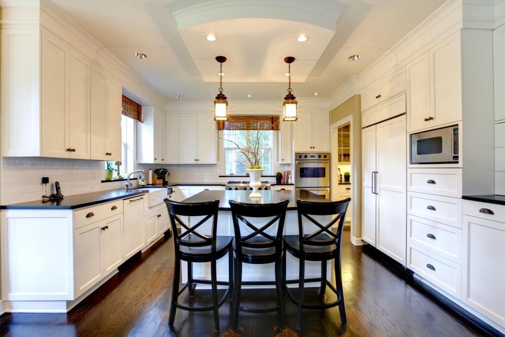 White large luxury modern kitchen with dark floor