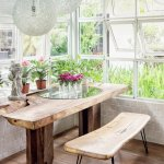 Dining room interior with wooden furniture and plants