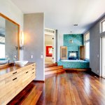 Bathroom interior with turquoise tile wall trim